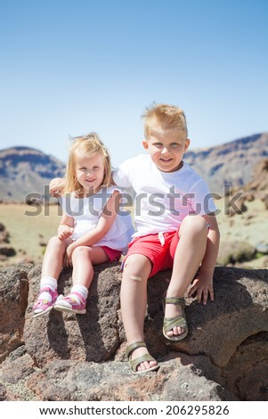 boy and girl on the rock