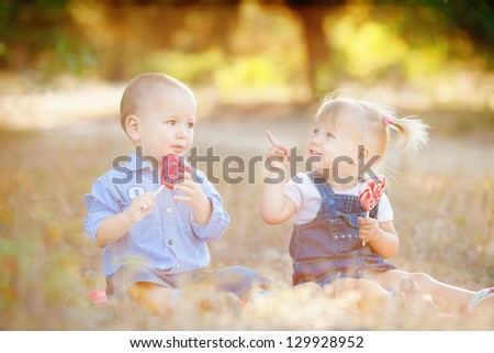Boy and girl playing in summer prk. Kids outdoor.