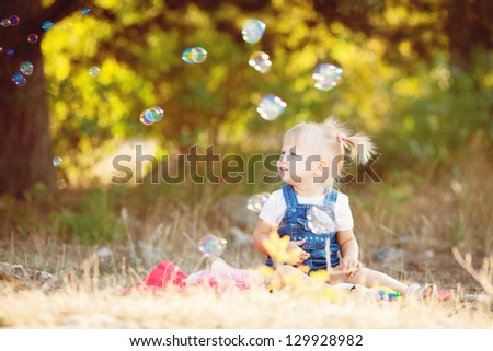 Boy and girl playing in summer prk. Kids outdoor. - stock photo