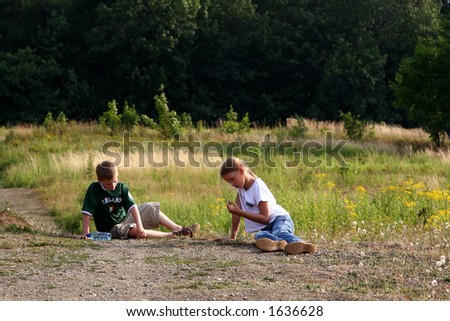 Boy and girl resting on the grass