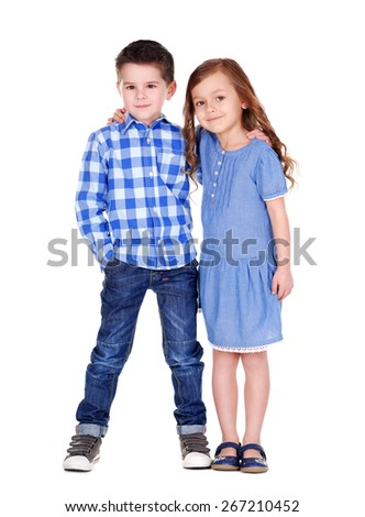 boy and girl standing together full length portrait - stock photo