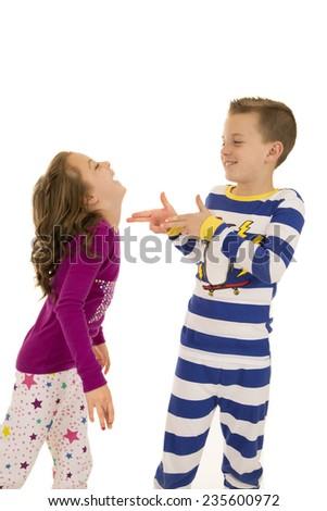 Boy and girl wearing winter pajamas playing - stock photo