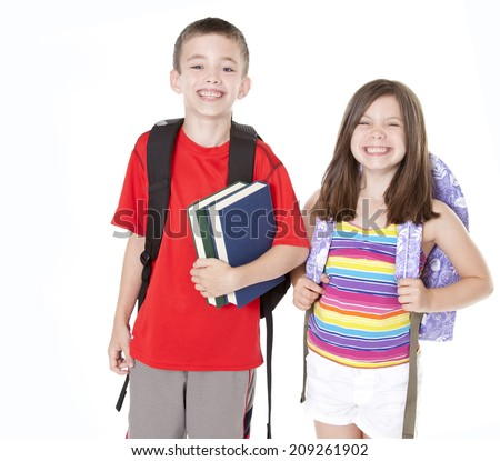 Boy and girl with backpacks and books isolated on white. - stock photo