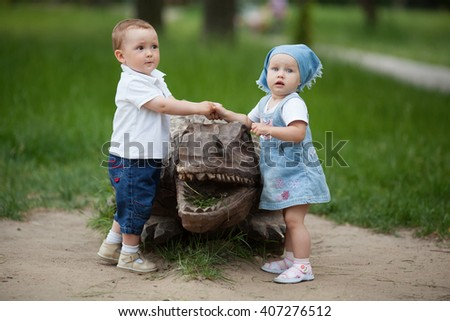 boy and girl with wooden crocodile