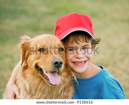 Boy and Golden Retriever - stock photo