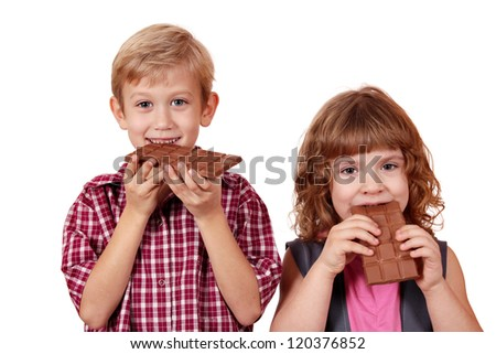 boy and little girl eating chocolate - stock photo
