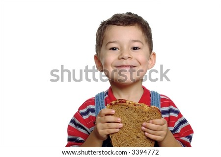 Boy and peanut butter sandwich - stock photo