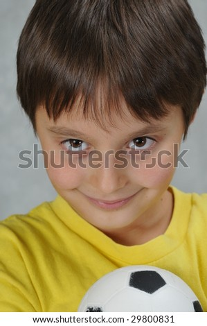 Boy and soccer ball - stock photo