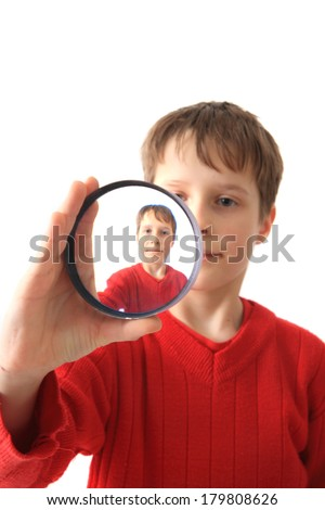 boy and special glass (original portrait) isolated on the white background - stock photo