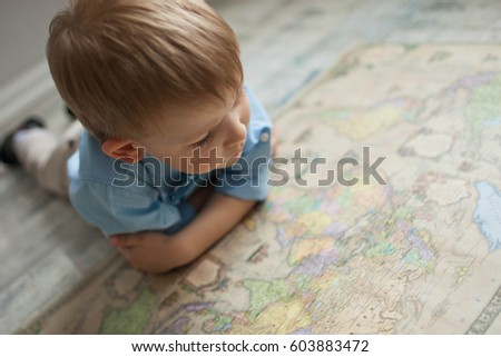 Boy and world map
