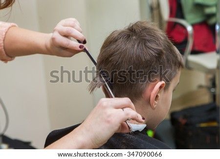 boy at barber , haircut