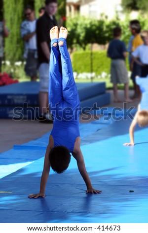 Boy at summer gymnastic camp - stock photo