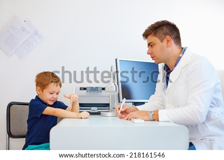boy at the pediatrician doctor, psychologist - stock photo
