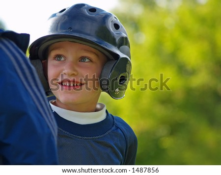 boy baseball player interacting with base coach - stock photo