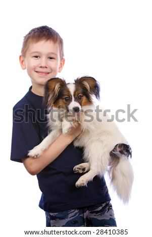 Boy bearing a puppy in his arms. - stock photo