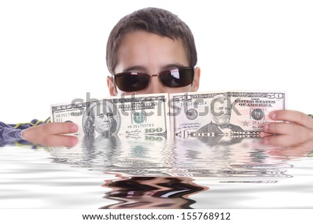 boy blinded by money, studio photo - stock photo