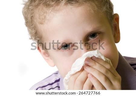 boy blow nose open eyes - stock photo
