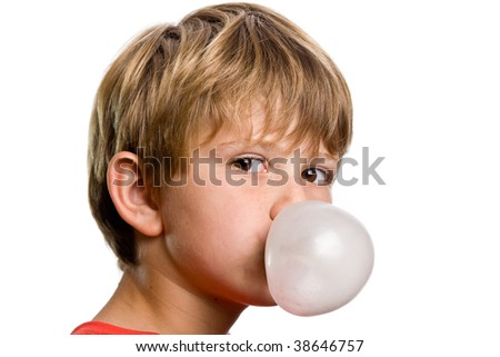 Boy blowing a bubblegum bubble - stock photo