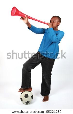 Boy Blowing Vuvuzela - stock photo