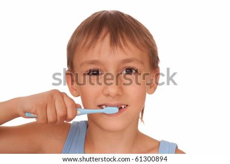 Boy brushing teeth on a white background - stock photo