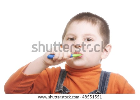 Boy brushing teeth with effort against white background