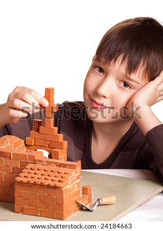 Boy building house isolated on white - stock photo
