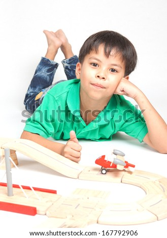 boy building  with colorful wooden blocks. Studio shot,