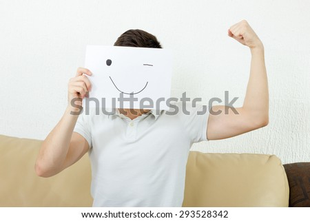 Boy calims his success.  Man celebrating  his success. Unknown man or person winking and holding out a raised hole arm, showing weak muscle.