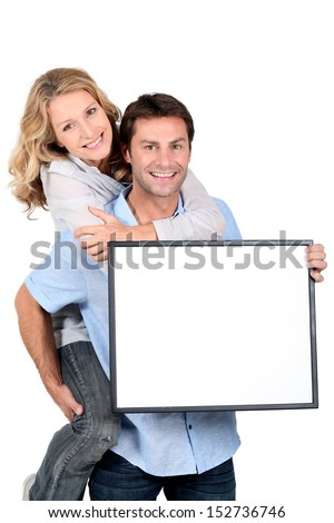 Boy carrying girl - stock photo