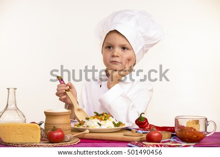 boy chef cooked cheese with vegetables