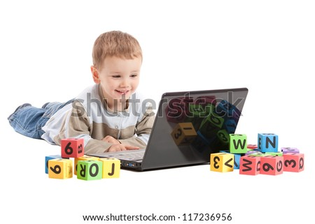 Boy child learning on laptop computer. Isolated on white.