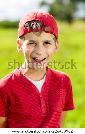 Boy Child Portrait Smiling Cute ten years old outdoor - stock photo