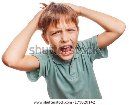 Boy child upset angry shout produces evil face portrait isolated large