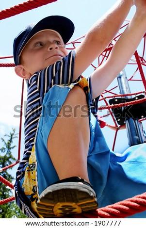 boy climbing on ropes - stock photo