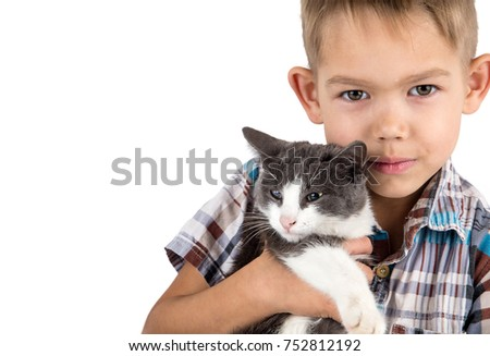 boy closeup holding the kitten on hand white background