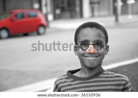 boy clowning around in a disguise - stock photo