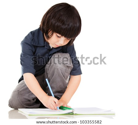 Boy coloring a book - isolated over a white background