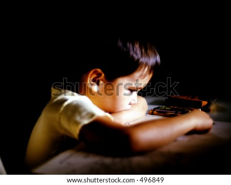 Boy Coloring at Table - stock photo