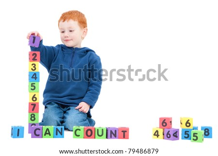 Boy counting numbers with blocks and saying I can count. Isolated on White - stock photo