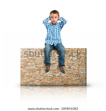 Boy covering his ears on rectangular placard - stock photo