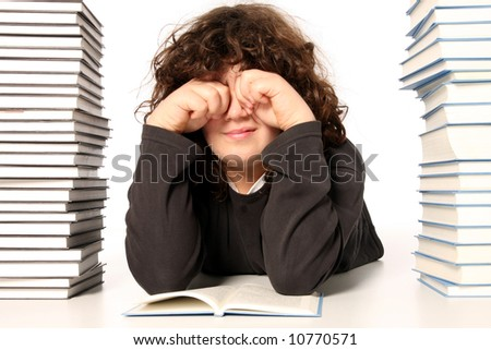 boy crying and and many books on white background - stock photo