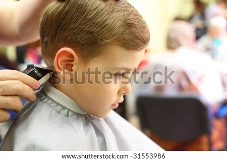 Boy cut in hairdresser's machine - stock photo