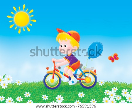 boy cycling on the grass in summer day - stock photo
