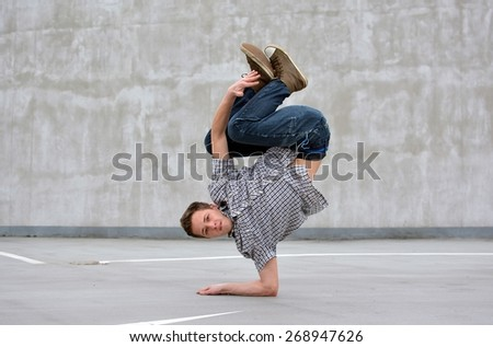 Boy dancing breakdance on the street - stock photo