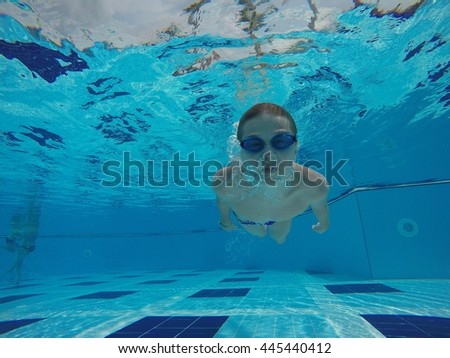 boy dive in a pool - stock photo