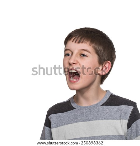 boy doing facial expressions, isolated on white background - stock photo
