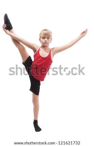 Boy doing vertical splits, on white background - stock photo