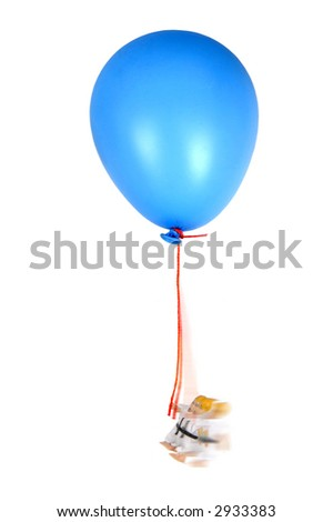boy doll swinging from balloon on white background - stock photo
