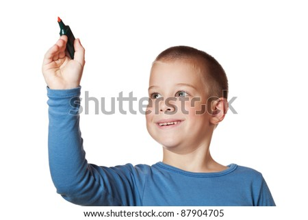Boy drawing with a  marker - stock photo