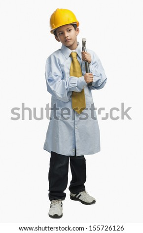 Boy dressed as an architect and holding hammer - stock photo